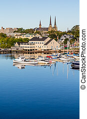 Church and Marina in Charllotetown - Small fishing boats in...