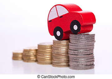 Auto industry - red car over a lot of stacked coins