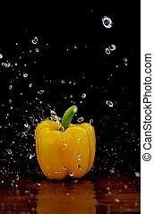 Yellow pepper in water stream
