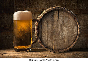 Beer barrel with glass on table wooden background - Beer...