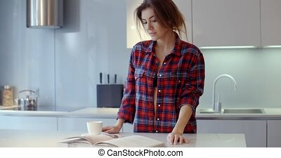 Beautiful Girl Spending Morning in Her Kitchen She Wearing...