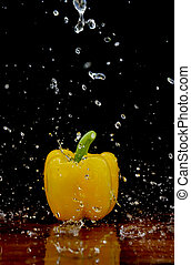 Yellow pepper in water stream