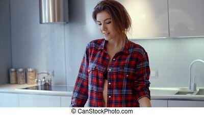 Cute Young Woman in Her Kitchen She Having Coffee in The...