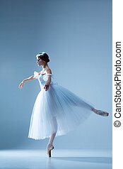 Portrait of the ballerina on blue background - Portrait of...