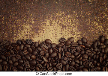 Dark roasted coffee beans on shabby chic surface
