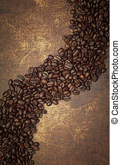 Dark roasted coffee beans on vintage grunge surface