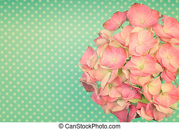 Pretty pink hortensia flower on a green vintage polka dot...