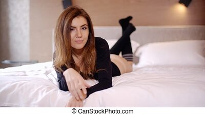 Beautiful Young Woman Lying on Her Bed and Relaxing She...