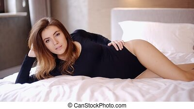 Sensual Girl Relaxing in Her Bedroom She Wearing Black...