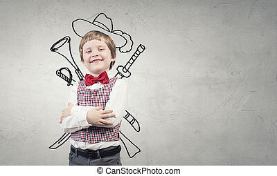 Lets play pirates - Portrait of young boy with drawn hat and...