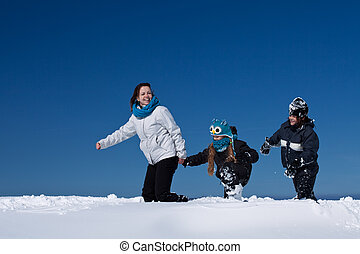 Winter fun in the deep snow - family enjoying the walk