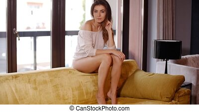 Beautiful Friendly Young Woman on Her Sofa - Beautiful...