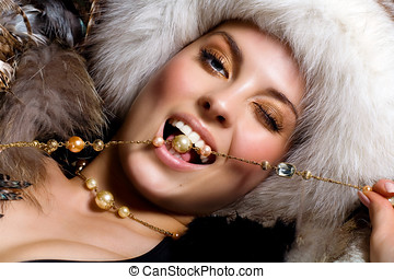 Dolce Vita - Model dressed in fur and jewelry.