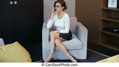Business Woman Chatting on Her Mobile Phone - Young...
