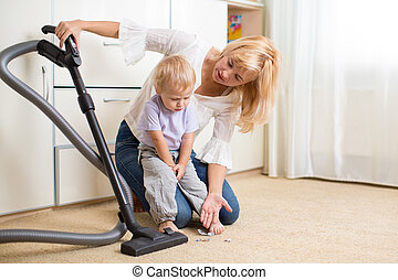 Mother teaches her child son room cleaning
