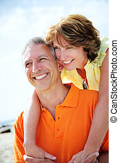 Happy mature couple smiling and embracing