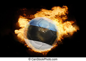 football ball with the flag of estonia on fire - football...