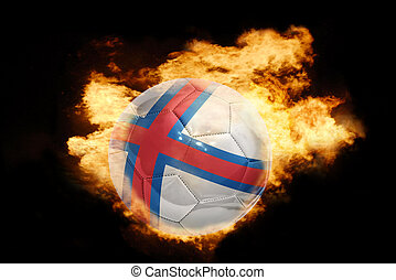 football ball with the flag of faroe island on fire -...