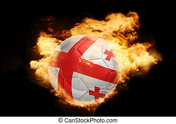 football ball with the flag of georgia on fire - football...