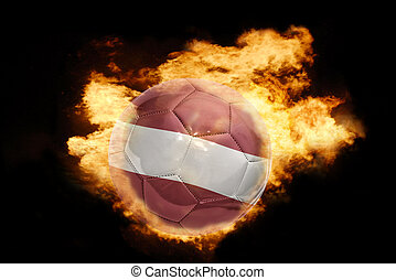 football ball with the flag of latvia on fire - football...