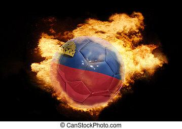 football ball with the flag of liechtenstein on fire -...