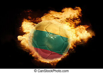 football ball with the flag of lithuania on fire - football...