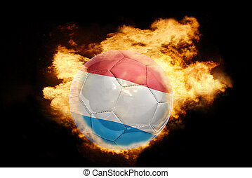 football ball with the flag of luxembourg on fire - football...