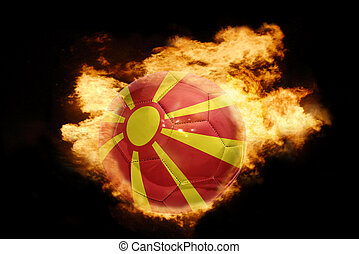 football ball with the flag of macedonia on fire - football...