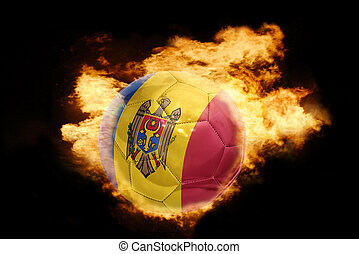 football ball with the flag of moldova on fire - football...