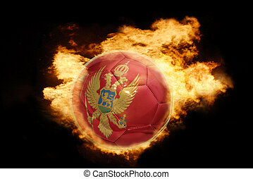 football ball with the flag of montenegro on fire - football...