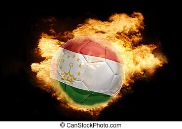 football ball with the flag of tajikistan on fire - football...