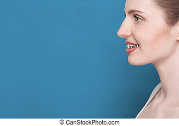 beautiful girl with braces - profile woman face with smile...
