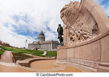 Utah Capitol building with monument and statue
