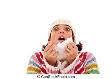 woman sneezing to a tissue - woman sneezing to a paper...
