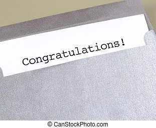 Congratulations - The word Congratulations on a piece of...