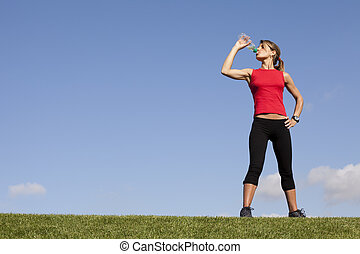 woman refreshing after the exercise - young sporty woman...