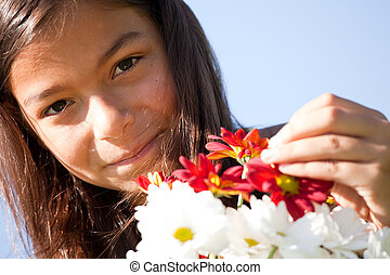 Little child with fresh flowers