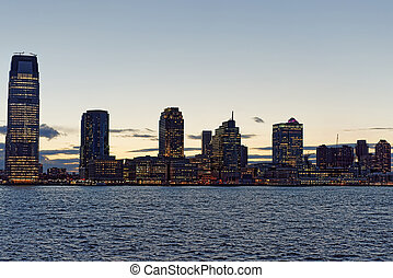 Jersey City skyline with skyscrapers at night