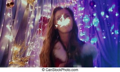 girl having fun with Christmas lights