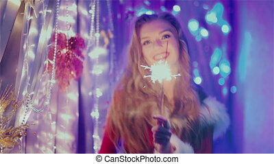 girl with braces dancing with sparklers HD