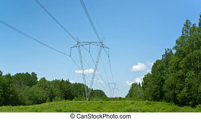 High-voltage line of electricity transmissions on field ,...