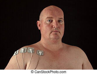 male with tens senors on his body for massage - photo male...