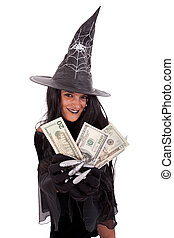Halloween witch showing the money isolated on white