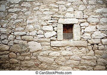 Stone wall with small window texture background - Stone wall...