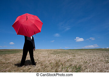 Insurance agent - Businessman finding protection outside in...