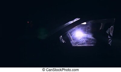 sits man in car at night and touches of blue goes light -...