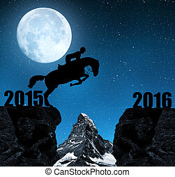 Concept New Year 2016 - The rider on the horse jumping into...