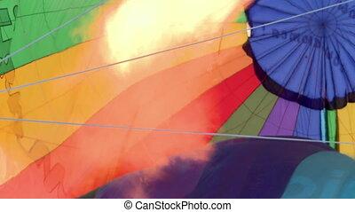 View of fire heats balloon, close-up - View of fire heats...