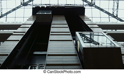 the movement of elevators in shopping center