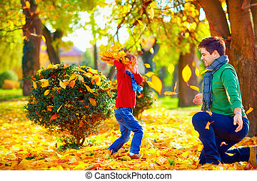 happy family having fun in colorful autumn park